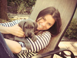 Brittany Maynard, 29, who is terminally ill with brain cancer, sits with her Great Dane, Charley. Maynard moved to Oregon where doctor-assisted suicide is legal.